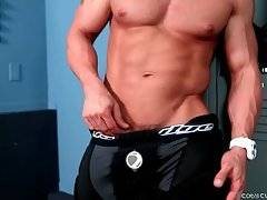 Cody Cummings lets his hands wander all over his muscles.